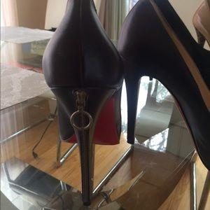 Gorgeous Christian Louboutin zipper pumps